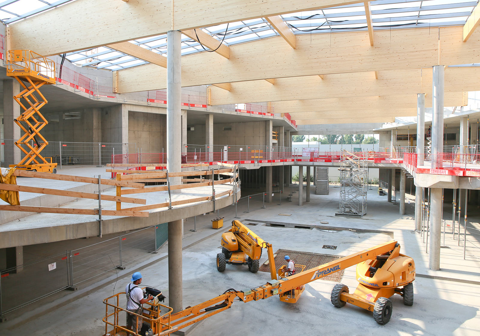The powerful timber construction of the roof soars over the new mall. Photo: Katharina Schiffl