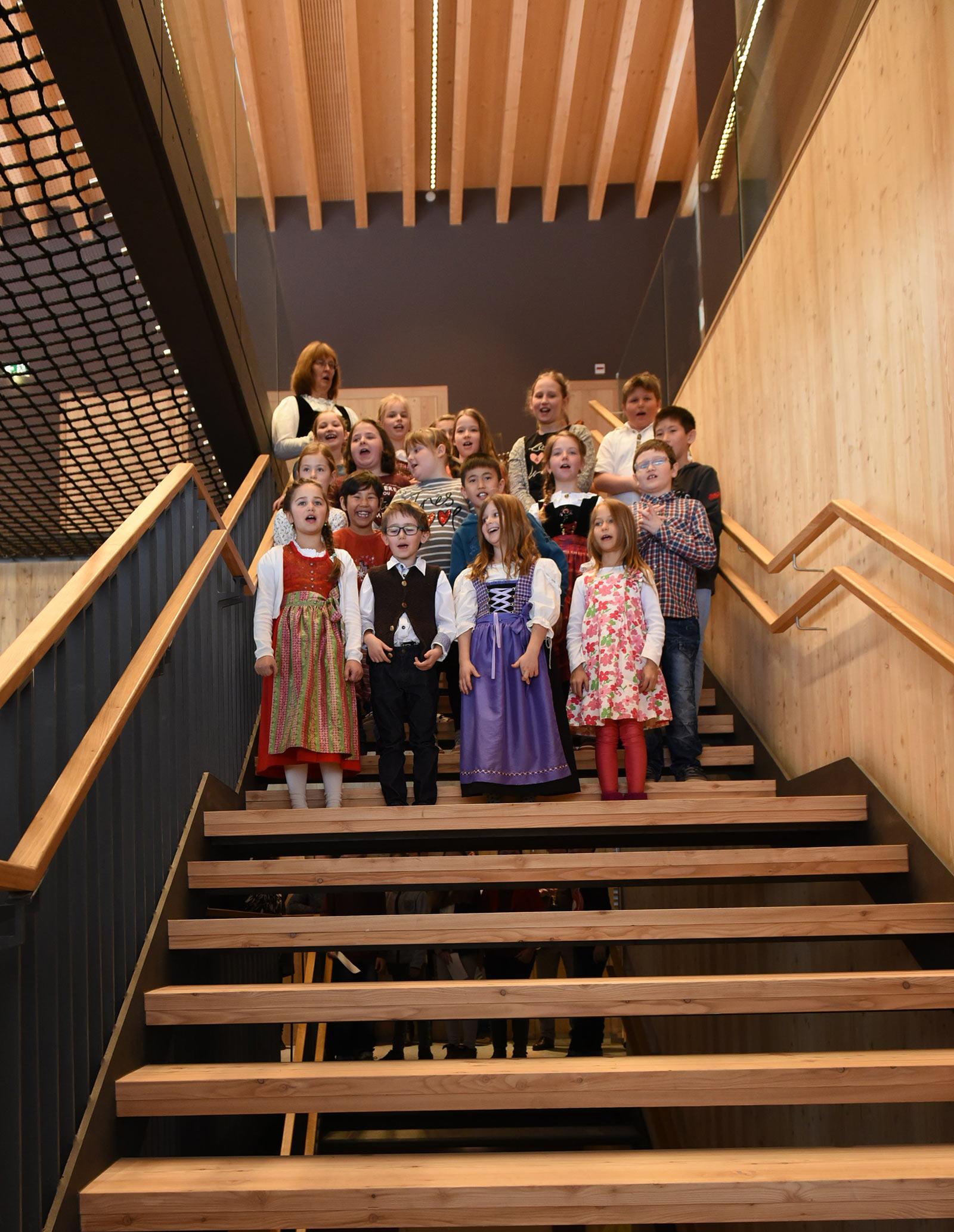 Children singing in the new school building. Photo: ATP