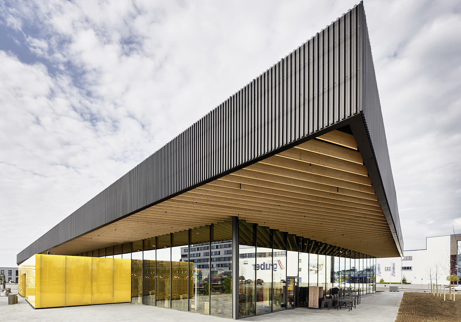 Glass façade and timber roof construction. Photo: Becker